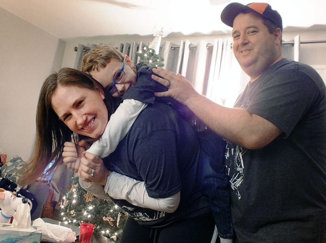 Abby's daughter Chele and husband Tom pose with our grandson Paul in their house. We made an image just like this in this exact spot in May 2011, when Paul was just five months old, and have been making a similar image ever since.