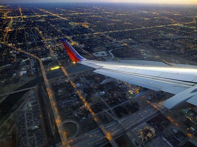 My Southwest Airlines Boeing 737-300 flight from Dallas Love Field, the second leg in my trip home, turns a long final to Will Rogers World Airport in Oklahoma City.
