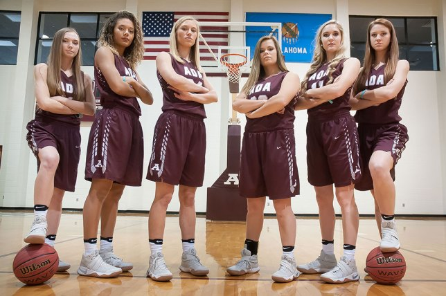 """The Ada Lady Cougar senior basketball players pose for their """"we're tough"""" picture at media day. The booster club ended up using this image for a banner they hung at the Cougar Activity Center. From left to right are Kaitlyn """"Katy"""" Redman, Madalyn Jessepe, Aleli Thomsen, Bree Willis, McKenzie Dean, and Payton Taylor."""