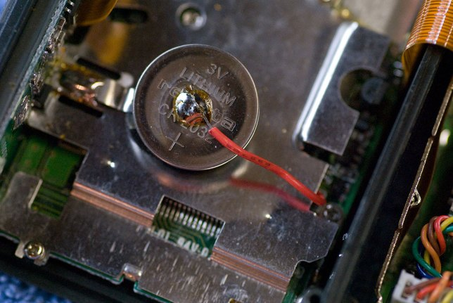 This is the dead CR-2032 button battery that I soldered in about three years ago.