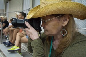 Abby photographs an animal show at the Oklahoma State Fair,