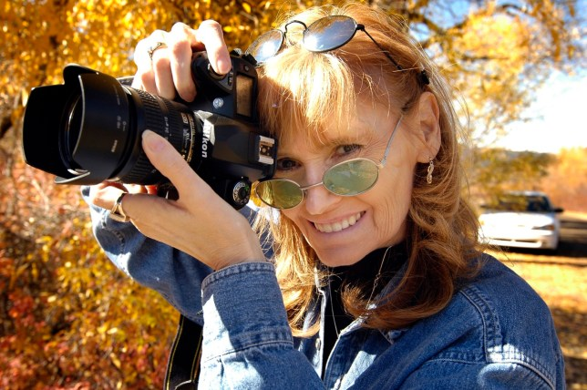 Abby flashes me her incredible smile as we travel in southern Colorado on our first anniversary vacation, Mokee Mokee, in October 2005.
