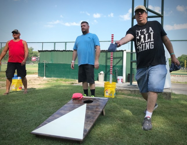 """Coworker Jeff Cali, right, sports a """"Cali"""" hat and """"Cali"""" short as he and I compete in yesterday's cornhole tournament in Stonewall, Oklahoma. The double-elimination affair lasted more than four hours."""