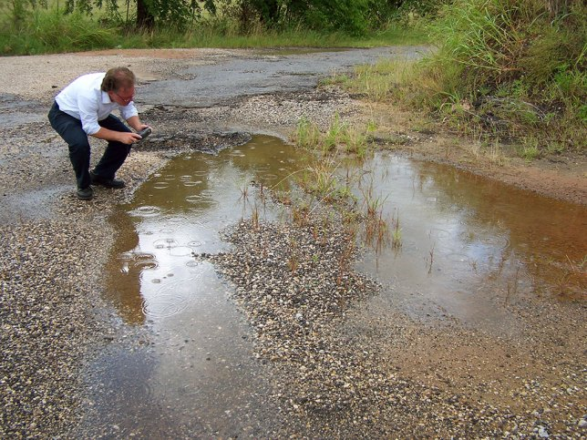 Robert photographs a puddle on Dog House Road.