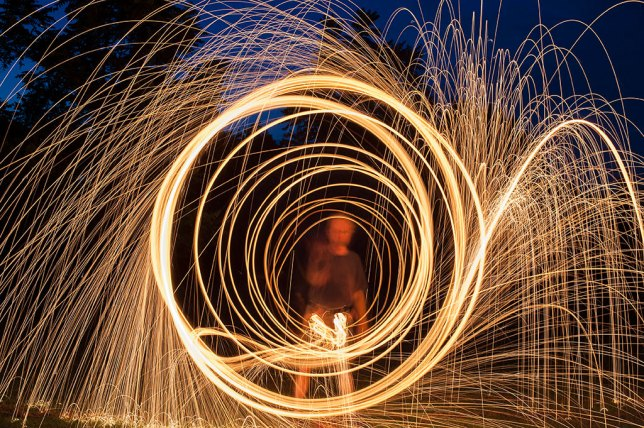I hadn't played with the spinning/burning steel wool trick in a couple of years, so Robert and I made it happen.
