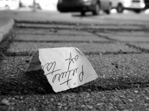 I saw this note in the street and photographed it some years ago, but never really found a use for it. Here it is for your consideration.