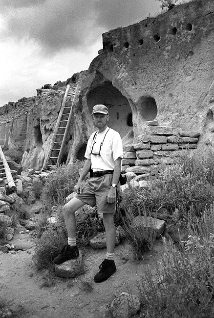 The author poses for a photo at Puyé Cliff Dwellings.
