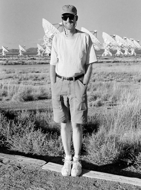 The author smiles at the Very Large Array near Magdalena, New Mexico.