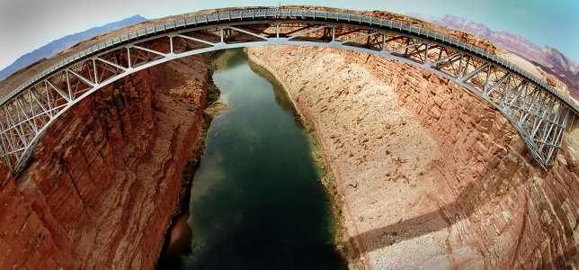This expensive fisheye view of Navajo Bridge looks south and shows are highway bridge above the Colorado River.