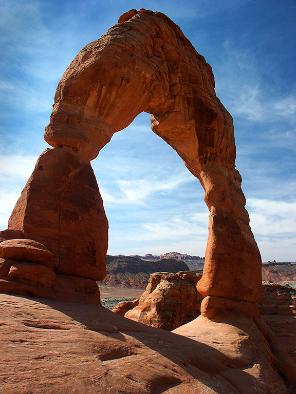 Mid-morning light shines on Delicate Arch in Arches National Park.