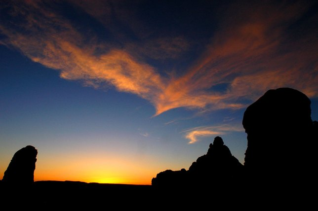The sky takes on color well after sunset in the Garden of Eden at Arches National Park.