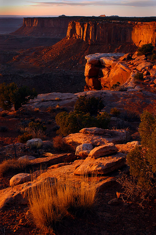 The western-facing cliffs at Grand View Point gather last light at Canyonlands.