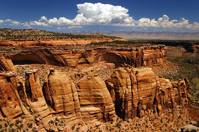 One of the signature formations of this park is the Coke Ovens. In the distance to the north are the Book Cliffs.
