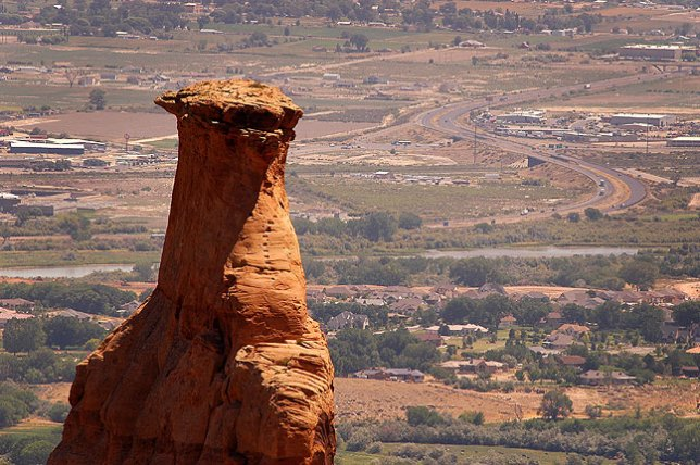Sandstone pinnacle with the town of Grand Junction, Colorado in the background.