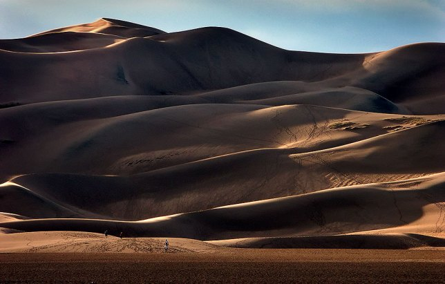 This is one of my favorite images of Great Sand Dunes due to the presence of people and tracks showing how huge the dune field is.