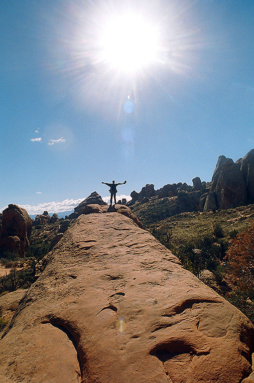 The author stands at the end of a sandstone fin in the Devil's Garden section of Arches National Park, Utah.