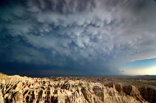 A thunderstorm creates dramatic mammatus clouds over Badlands National Park, South Dakota.
