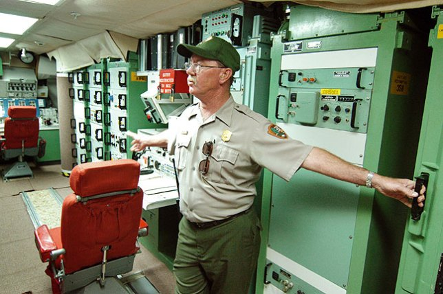 A ranger gives a tour of a launch control room at Minuteman Missile Silo National Historic Site.