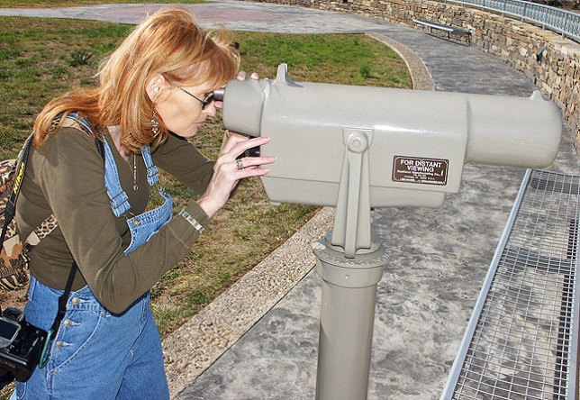 "Abby looks through a telescope at ""our"" rest stop in the Texas panhandle."