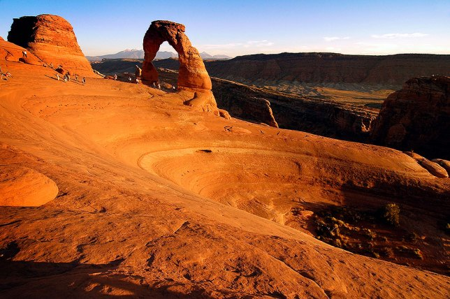Delicate Arch, where our marriage began a year earlier, shines in evening light.