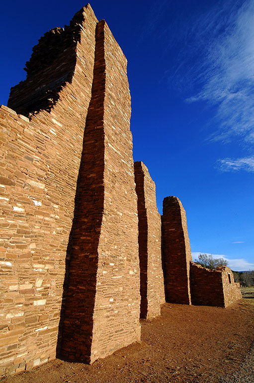The Abó Ruin of Salinas Pueblo Missions National Monument stands tall in clear afternoon light.