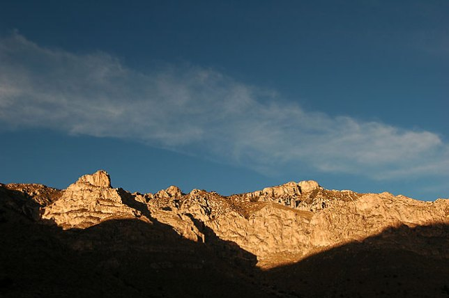A late afternoon shadow creeps up on cliffs on the Devil's Hall trail, Guadalupe Mountains.