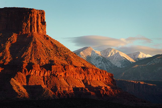 The La Sal Mountains and the mesas of Castle Valley, Utah take on last light. We spotted this on our way back to Moab after hiking at Fisher Towers.