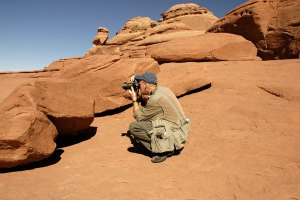 The author makes pictures at Delicate Arch.