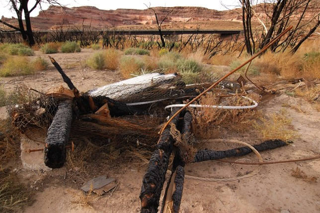 The 92-year-old Dewey bridge across the Colorado River near Moab was destroyed by a fire that began with a boy playing with matches in April 2008.