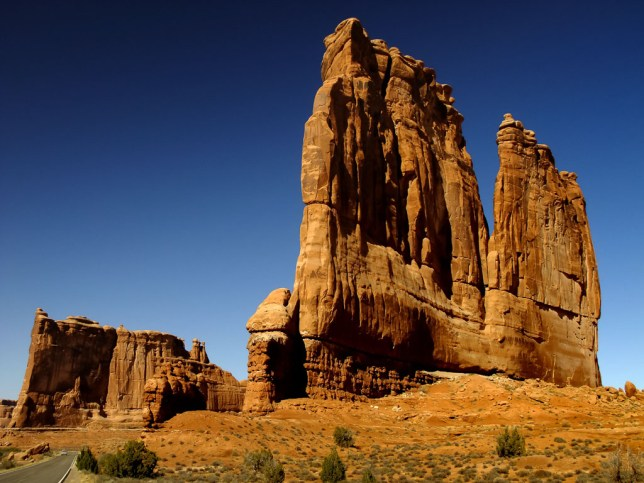 The Courthouse Towers stand tall on the main road at Arches National Park.