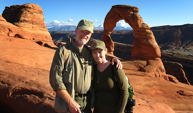 Abby and I pose in the spot where our marriage began, Delicate Arch in Arches National Park.