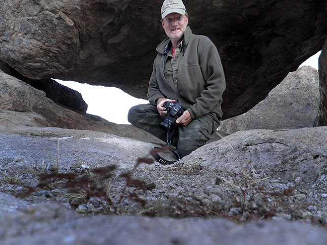 Posing under a shelf of rock at City of Rocks, near the end of my adventure there.