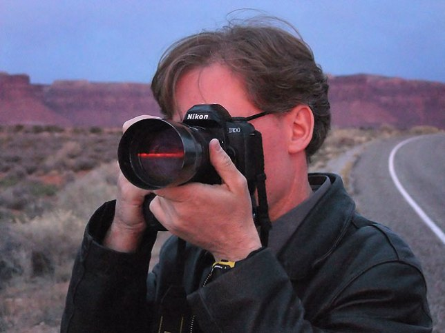 Robert points his camera at a band of brilliant color during sunset as we exit Canyonlands.