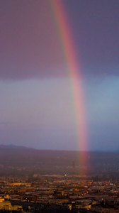 "Morning rainbow over Las Vegas; one presumes the ""end of the rainbow"" is a casino."