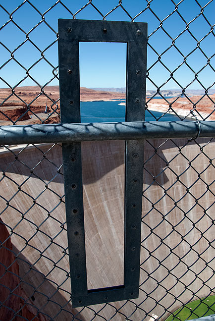 This portal through the fence on the bridge walkway downstream from Glen Canyon Dam is just large enough for a camera or phone. I wonder how many of such devices end up in the river below each year.