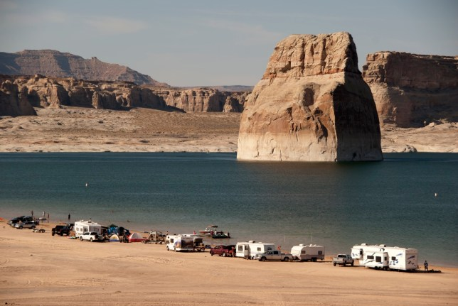 On my way back to Page, Arizona, I stopped at Lake Powell's Lone Rock site. Campers and RVs line the shore.