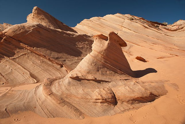 The rim above Waterholes Canyon is also beautiful, with fields of elegant sandstone formations like this one.