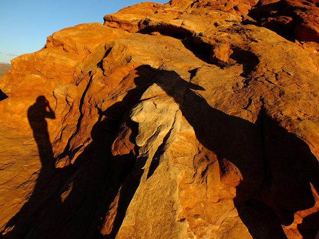 """Our shadows taller than our soul...""; Jim and I photograph our shadows at the North Window in Arches."