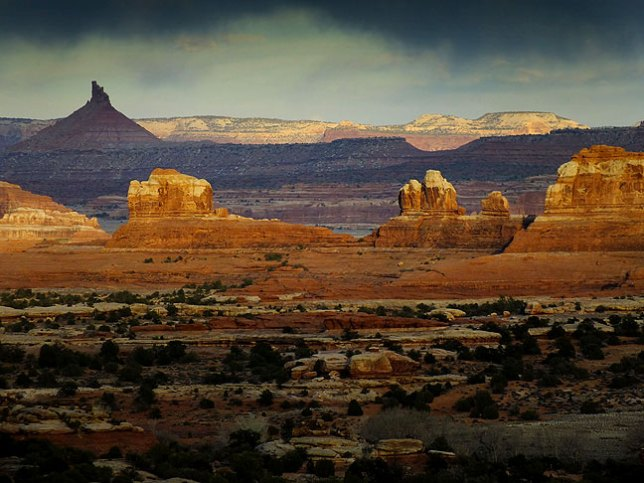 Last light graces Wooden Shoe Butte and Sixshooter Peak at Canyonlands National Park, Utah.