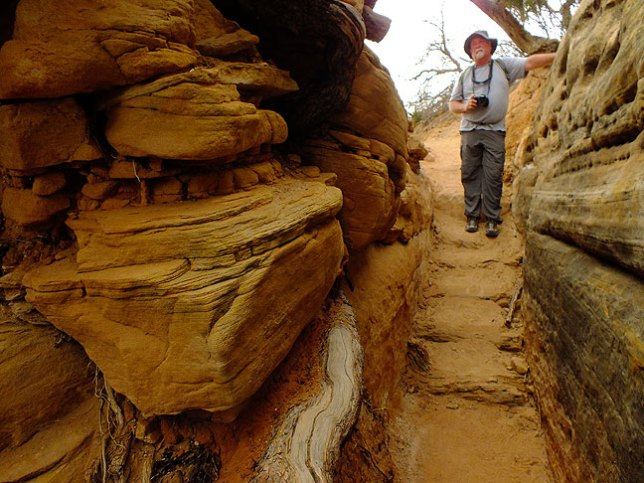 "Jim enters ""the crack,"" a signature formation on the Chesler Park trail, on our way back to Elephant Hill."
