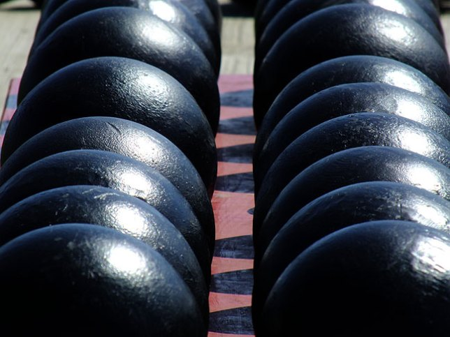Replica cannon balls sit near the huge iron guns of Fort McHenry.
