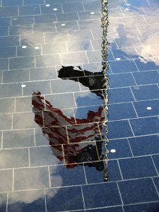 The U. S. Flag is reflected in the waters of the black granite reflecting pool at the Korean War Memorial.