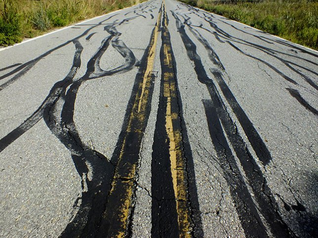 These marks were present on the road to the French Lake trail head. I don't know what made them.