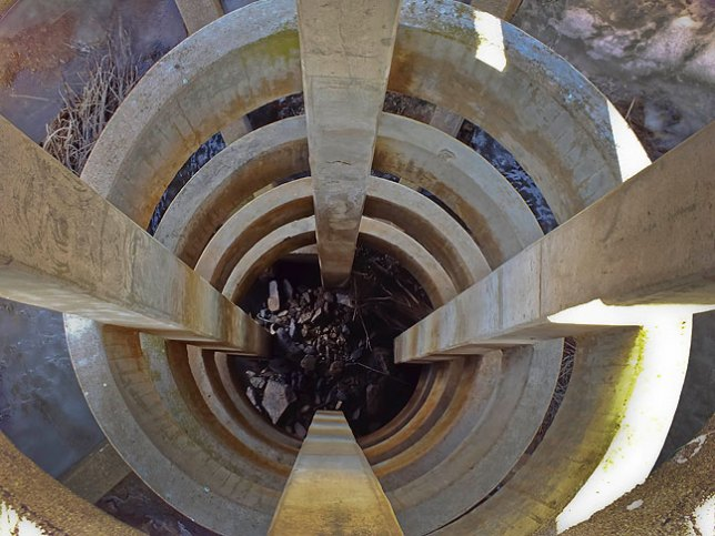 This view looks down the spiral spillway at French Lake Dam.