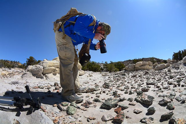 Looking a bit like an astronaut photographing a distant planet, Greg makes macro images of the geology of Penistaja.