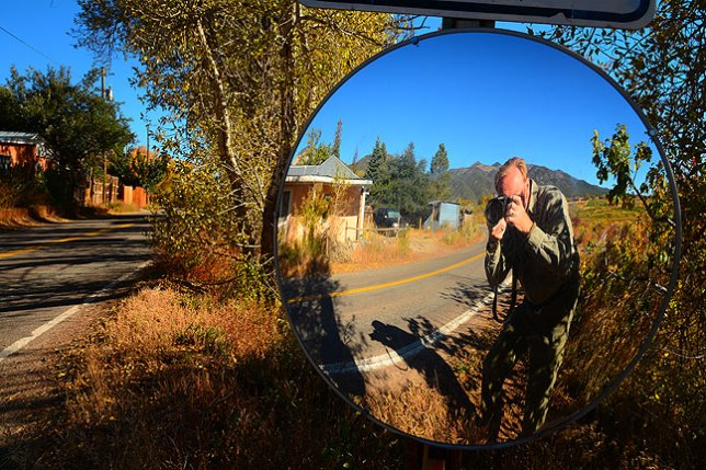 I made this self-portrait in a blind corner mirror on the highway in Arroyo Seco, New Mexico.