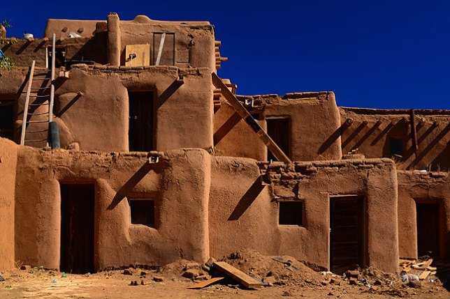 This image shows some of the classic multi-story architecture of Taos Pueblo.