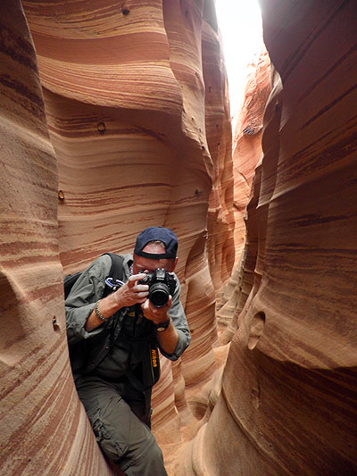The author makes pictures in Zebra Slot Canyon.