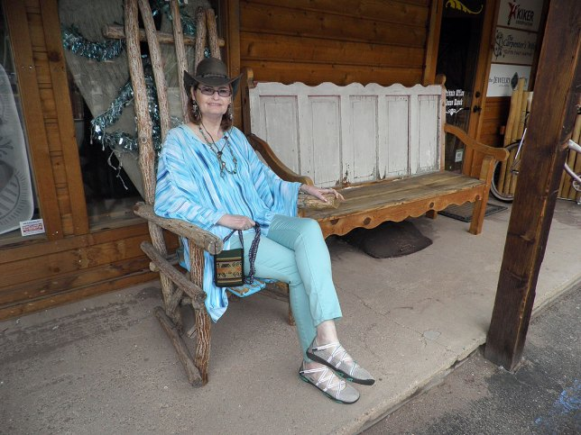 Abby poses on a bench at a shop in Red River, New Mexico.