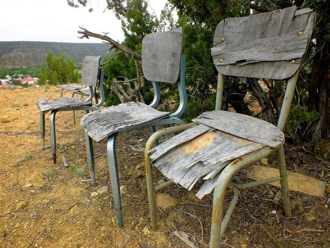 Weathered chairs, presumably in place for visitors or worshippers, sit close to the Grotto at Villanueva.
